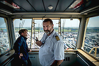 Captain Franz Holmberg steers the Mary Maersk, the largest container ship in the world, into the port at Bremerhaven, with the help of a local pilot (left).