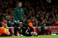 28th November 2019; Emirates Stadium, London, England; UEFA Europa League Football, Arsenal versus Frankfurt; Filip Kostic of Eintracht Frankfurt is fouled and writhes on the ground - Editorial Use