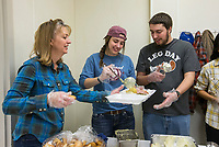 NWA Democrat-Gazette/BEN GOFF @NWABENGOFF<br /> Bobbi Talarski (from left), daughter Hannah Talarski and son Caleb Talarski help fill takout boxes Thursday, Nov. 28, 2019, during the annual Thanksgiving meal distribution at the First Baptist Church Olive Street campus in Rogers. <br /> <br /> Paul Olinger, a church member who helped coordinate the meal, said the event started 20 years ago 'As an outreach of the church to show the love of Christ in the community'. Volunteers from the church and the community cooked, packaged and delivered boxed meals that included ham, green beans, mashed potatoes and deserts. <br /> <br /> Open to anyone, a line wrapped around the room as families picked up boxes of food to take home, but Olinger estimates that 98 percent of the meals are delivered by volunteers.