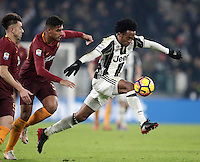 Calcio, Serie A: Juventus vs Roma. Torino, Juventus Stadium,17 dicembre 2016. <br /> Juventus' Juan Cuadrado, right, is challenged by Roma's Emerson Palmieri, center, and Stephan El Shaarawy, during the Italian Serie A football match between Juventus and Roma at Turin's Juventus Stadium, 17 December 2016.<br /> UPDATE IMAGES PRESS/Isabella Bonotto