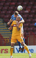 Frazer Wright climbs above Michael Higdon to win the aerial ball in the Motherwell v St Johnstone Clydesdale Bank Scottish Premier League match played at Fir Park, Motherwell on 28.4.12.