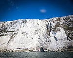 SUP exploring the caves and cliffs around Freshwater Bay on the Isle of Wight