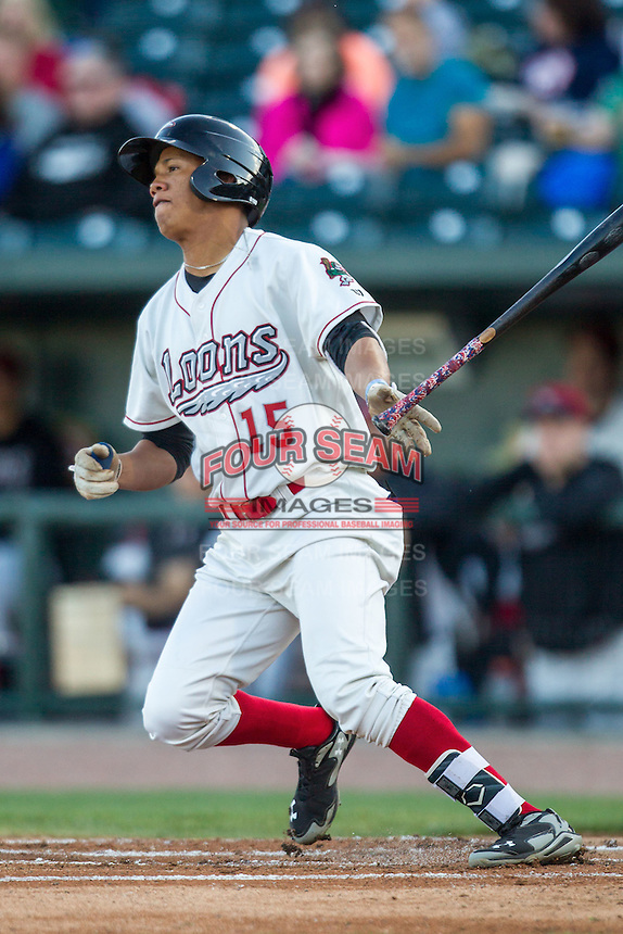 Great Lakes Loons outfielder Ariel Sandoval (15) follows through on his swing against the South Bend Cubs on May 18, 2016 at Dow Diamond in Midland, Michigan. Great Lakes defeated South Bend 5-4. (Andrew Woolley/Four Seam Images)