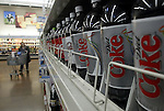 A Wal-Mart customer peruses the soda aisle Thursday, March 2, 2006, in Grove City, Ohio.<br />