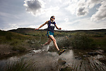 © Joel Goodman - 07973 332324 . 21/07/2014 . Oldham , UK . Gaynor running on the moors and through the rocks above Dovestone Reservoir . Runner GAYNOR KEANE recently completed the Bob Graham Challenge in under 24 hours . Photo credit : Joel Goodman