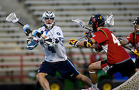 Billy Bitter (4) of North Carolina passes the balla way from Brett Schmidt (44) of Maryland during the ACC men's lacrosse tournament semifinals in College Park, MD.  Maryland defeated North Carolina, 13-5.