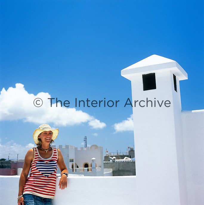 Portrait of Emma Wilson on the roof terrace of her house in Essaouira