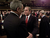 United States Secretary of State Colin Powell, left, is greeted by  United States President George W. Bush, center, before his speech before a Joint Session of Congress, Tuesday, February 27, 2001 in Washington, D.C.  Supreme Court Justice Stephen Breyer, is seen at right.  Breyer is the only member of the court to attend the speech. <br /> Credit: Doug Mills / Pool via CNP