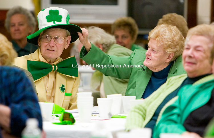 OXFORD, CT- 13 MARCH 07- 031207JT02- <br /> Kitty Bialecki, right, adjusts Scotty Blackwood's hat during the St. Patrick's Day Party at the Oxford Senior Center on Monday. <br /> Josalee Thrift Republican-American