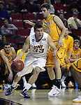 Northern Iowa's Wyatt Lohaus (33) drives past Wyoming's Jack Bentz  (13) during the 2015 NCAA Division I Men's Basketball Championship March 20, 2015 at the Key Arena in Seattle, Washington.   Northern Iowa beat Wyoming 71 to 54.   ©2015.  Jim Bryant Photo. All Rights Reserved.