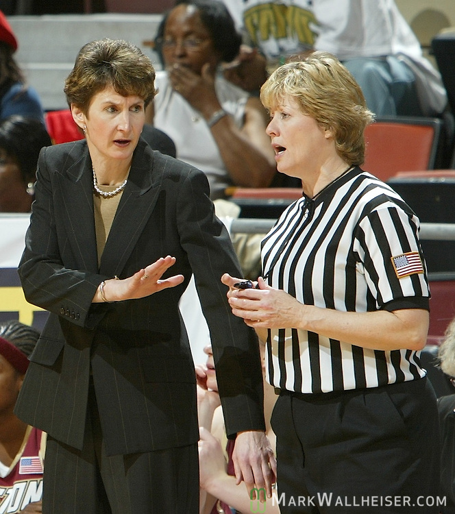 Boston College head coach Cathy Inglese (L) has a discussion with the referee during her team's 71-60 loss to Florida State February 26, 2006.