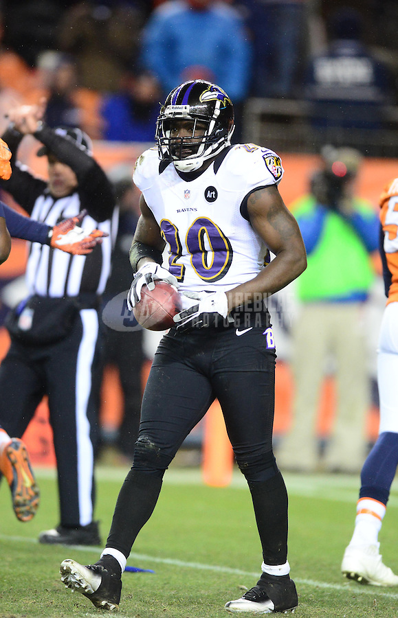 Jan 12, 2013; Denver, CO, USA; Baltimore Ravens safety Ed Reed (20) against the Denver Broncos during the AFC divisional round playoff game at Sports Authority Field.  Mandatory Credit: Mark J. Rebilas-