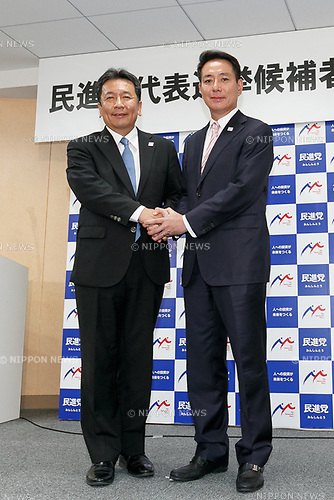 (L to R) Democratic Party former secretary-general Yukio Edano and former Foreign Minister Seiji Maehara shake hands during a news conference to announce their candidacy to lead Japan's largest opposition party on August 21, 2017, Tokyo, Japan. Edano and Maehara are competing to succeed current leader Renho and rebuild Japan's opposition. (Photo by Rodrigo Reyes Marin/AFLO)