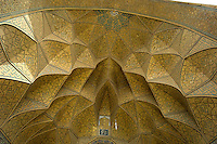 This is a view up into the arch of the west eivan of the Jameh (Friday) Mosque in Isfahan, Iran. The west eivan was built by the Seljuks in the 12th century but later decorated by the Safavids in the 16th century.