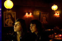 Los Angeles, Calif., Dec. 16, 2008 - Ramona Gonzalez (L) and Emily Jane of the band Nite Jewel at their favorite bar, Footsies, in the Echo Park section of Los Angeles.