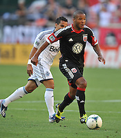 Ethan White( 15) of D.C. United runs with the ball from Camilo Sanvezzo (7) of the Vancouver Whitecaps FC. The Vancouver Whitecaps FC defeated D.C. United 1-0, at RFK Stadium, Saturday June 29 , 2013.