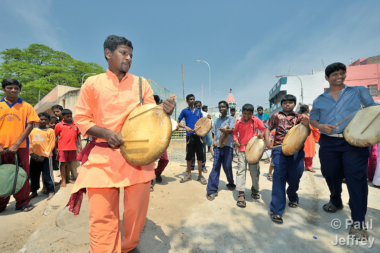 Members of the Police Boys Club drum as they march through the Egmore neighborhood of Chennai, a city in the southern India state of Tamil Nadu. The boys attract residents' attention and then present street theater on a variety of themes.
