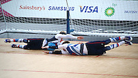1.09.2012 London, England. Niall Graham (GBR) and Michael Sharkey (GBR) dive for a save during the Men's Goalball Preliminary Round Group A between Great Britain and Sweden in Day 3 of the London Paralympics from the Copper Box.