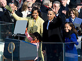 Washington, DC - January 20, 2009 -- United States President Barack Obama and his family wave to the crowd after he took the oath of office as the 44th President of the United States in Washington, DC, USA, 20 January 2009. Obama defeated Republican candidate John McCain on Election Day 04 November 2008 to become the next U.S. President.Credit: Matthew Barrick - CNP