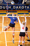 BROOKINGS, SD - OCTOBER 5:  Wagner Larson #11 from South Dakota State University tries to get a kill past Audrey Reeg #4 from the University of South Dakota in the second game of their match Saturday night at Frost Arena. (Photo by Dave Eggen/Inertia)