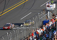 Apr 28, 2007; Talladega, AL, USA; Nascar Busch Series driver Bobby Labonte (77) takes the checkered flag ahead of Tony Stewart (33) during the Aarons 312 at Talladega Superspeedway. Mandatory Credit: Mark J. Rebilas