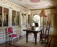 In the study a Florentine walnut chair is paired with a Medici table on an Aubusson rug