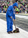 Seattle Seahawks ground crew sweeps up Skittles after running back Marshawn Lynch scored on a nine-yard touchdown run against the St. Louis Rams  during the third quarter at CenturyLink Field in Seattle, Washington on December 28, 2014.  The Seahawks officially wrapped up the No. 1 seed in the NFC playoffs shortly after beating the Rams, 20-6. Despite the Cowboys and Packers also winning to finish 12-4, the Seahawks (12-4) won the multi-team tiebreaker and earned home-field advantage throughout the playoffs for the second consecutive season.  ©2014. Jim Bryant Photo. All Rights Reserved.