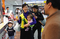 Mitsuyasu Uchibori talking to customers at his shop in Tokyo station, Tokyo, Japan, November 16 2009.