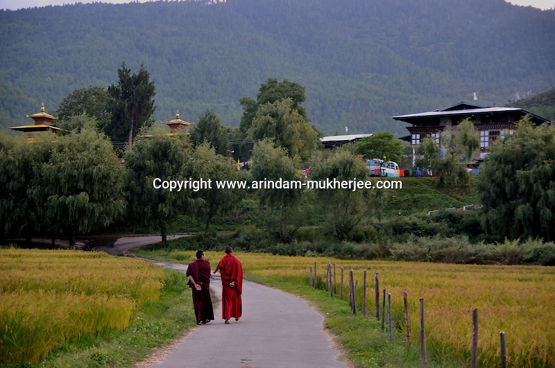 Buddhist lamas on a road in Paro. Arindam Mukherjee. Arindam Mukherjee..