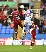 9th September 2017, Madejski Stadium, Reading, England; EFL Championship football, Reading versus Bristol City; Modou Barrow of Reading and Zak Vyner of Bristol City compete in the air