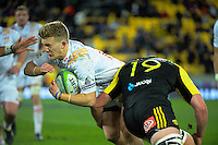 Mark Abbot tackles Damien McKenzie during the Super Rugby semifinal match between the Hurricanes and Chiefs at Westpac Stadium, Wellington, New Zealand on Saturday, 30 July 2016. Photo: Dave Lintott / lintottphoto.co.nz