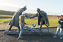 25/12/14<br /> <br /> Football fans from around the world kick a football around and pay their respects by a sculpture depicting two WW1 soldiers playing football during the famous Christmas Day truce in the field near Messine, Belgium, close to where the match was played in Flanders, Belgium.<br /> <br /> The sculpture, made in England, arrived in Flanders on Christmas Eve, and was first displayed in the town centre before being taken to the spot where the match was played. <br /> <br /> Sculpted by Andy Edwards the work is entitled &lsquo;All Together Now&rsquo;, recalling the song by the band The Farm - which was inspired by the truce. <br /> <br /> Chris Butler said: &ldquo;Castle Fine Arts are proud to have cast a number of war memorials over the years. We are honoured to support this sculpture for peace. I believe it will touch the hearts of millions.&rdquo;<br /> <br /> <br /> &ldquo;It will be a symbol of peace and hope and a call for a renewed worldwide cessation of violence in honour of those brave boys who &lsquo;joined together and decided not to fight&rsquo;&rdquo;.<br /> <br /> <br /> The statue depicts the meeting of a British and a German soldier over a football, deep in the mud between the lines on that first Christmas of the war. The soldiers appear to be shaking hands but  are not not quite touching, forming a space in which a visitor can insert their own hand to complete the union.  A chance for a moments reflection on how far we are from true peace and brotherhood and the part each of us has to play in that dream. We want the work to stand as both a celebration of this inspirational and heroic event and as symbol of hope and peace. <br /> <br /> The project was instigated some years ago, with the support of the Football Asscociation (FA), as football&rsquo;s contribution to the First World War commemorations. <br /> <br /> All Rights Reserved - F Stop Press. www.fstoppress.com. Tel: +44 (0)1335 300098