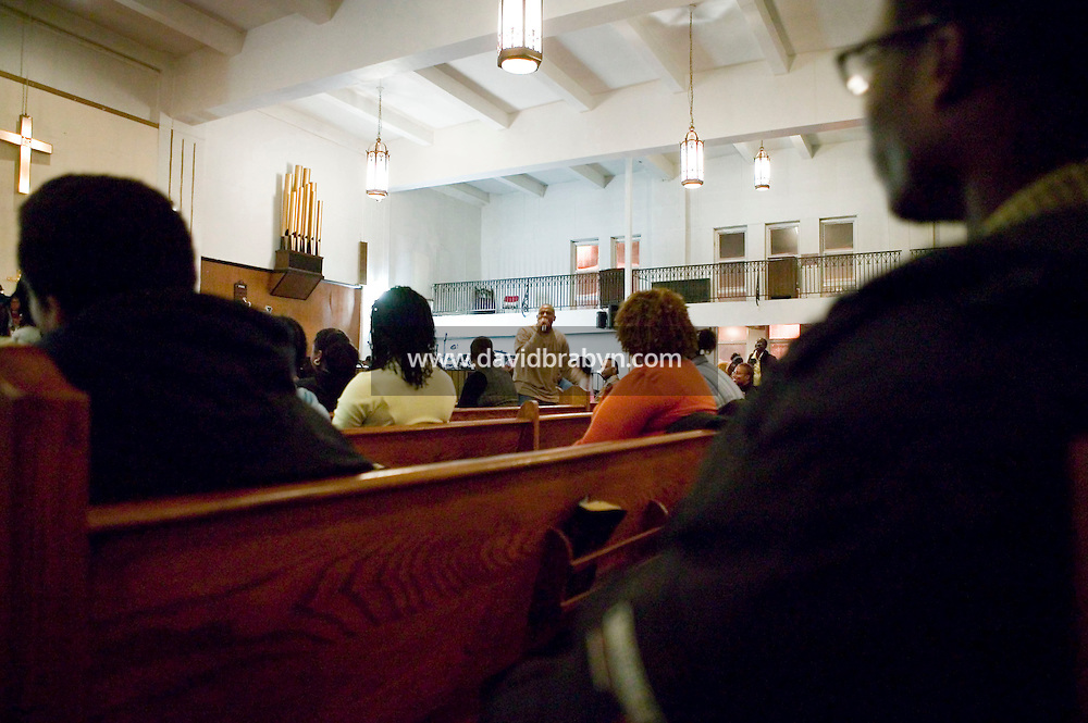 New York, USA - Congregation members listen to Reverend Stephen Pogue (C, background) during mass at the Greater Hood Memorial AME Zion Church, home of the Hip-Hop Church, in Harlem, New York, USA, 10 February 2005. Photo Credit: David Brabyn.
