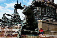 Animals and human figures adorn the base of the Washington Monument at Eakins Oval in front of the Philadelphia Museum of Art on Benjamin Franklin Parkway in Philadelphia, Pennsylvania, USA.