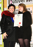 Adult Poetry runner up winner Phoebe Garity collecting her certificate from Mona Daly in the Mooreland on the night of the book launch..Picture: Shane Maguire / www.newsfile.ie.