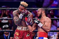 """Fairfax, VA - May 11, 2019: Julian J-Rock"""" Williams lands a right uppercut during Jr. Middleweight title fight against Jarrett """"Swift"""" Hurd at Eagle Bank Arena in Fairfax, VA. Julian Williams defeated Hurd to take home the IBF, WBA and IBO Championship belts by unanimous decision. (Photo by Phil Peters/Media Images International)"""