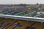 Supporters of Mansfield Town sitting in one of the stands at Field Mill stadium during an open day held for the club's supporters. Mansfield Town achieved promotion back to England's Football League by winning the Conference National in season 2012-13. Field Mill was the oldest ground in the Football League, hosting football since 1861 although some reports date it back as far as 1850, with Mansfield Town having played there since 1919.
