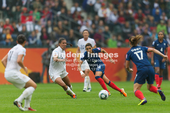MOENCHENGLADBACH, GERMANY - JULY 13:  Shannon Boxx of the United States (L) and Louisa Necib of France (R) eye the ball during a FIFA Women's World Cup semifinal match at Stadion im Borussia Park on July 13, 2011  in Moenchengladbach, Germany.  Editorial use only.  Commercial use prohibited.  No push to mobile device usage.  (Photograph by Jonathan P. Larsen)