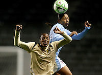 Chicago Red Star forward Cristiane (11) battles for a header with FC Pride forward Kandace Wilson (9).  The defeated the FC Gold Pride defeated the Chicago Red Stars 1-0 at Toyota Park in Bridgeview, IL on May 16, 2009.