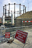 Footpath closure by a landmark Victorian gas holder in Kings Cross during work on the Channel Tunnel Rail Link, Central London.