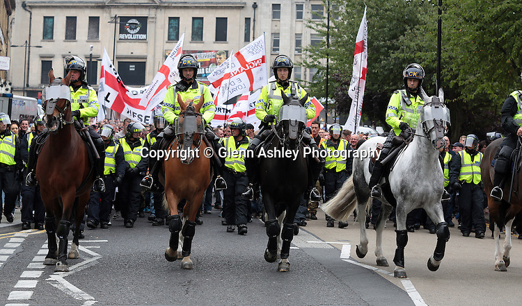 Members of the EDL protest through Rotherham town centre, Rotherham, United Kingdom on 13 September 2014. Photo by Glenn Ashley.