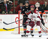 Jack Berger (Princeton - 9), Kyle Criscuolo (Harvard - 11) - The Harvard University Crimson defeated the Princeton University Tigers 3-2 on Friday, January 31, 2014, at the Bright-Landry Hockey Center in Cambridge, Massachusetts.