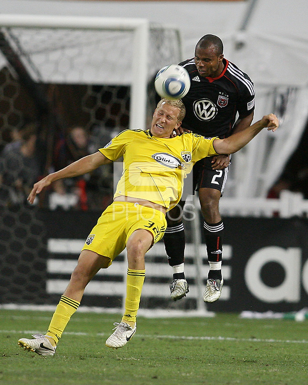 Julius James #2 of D.C. United  heads over Steven Lenhart #32 of the Columbus Crew during an MLS match at RFK Stadium on September 4 2010, in Washington DC. Columbus won 1-0.