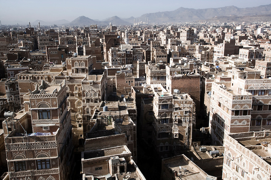 Yemen - Sana'a -  View over Old Sana'a. One of the main reasons why Sana'a is lacking water is the growing population, in the past 30 years, thousands of yemenis have left the countryside to move to the capital. Yemen's economy depends heavily on oil production, and its government receives the vast majority of its revenue from oil taxes. Yet analysts predict that the country's petroleum output, which has declined over the last seven years, will fall to zero by 2017. The government has done little to plan for its post-oil future. Yemen's population, already the poorest on the Arabian peninsula and with an unemployment rate of 35%, is expected to double by 2035..The trends will exacerbate large and growing environmental problems, including the exhaustion of Yemen's groundwater resources. Given that a full 90% of the country's water is used for agriculture, this trend portends disaster..Sanaa's well are expected to dry out by 2015, partly due to illegal drilling, partly because 40% of the city's water is diverted for qat production, and partly because conservation rules are difficult to enforce. Only 20% of the houses receive water, the other 80% has to collect it from pumps and wells. 15% of the urban population only uses bottled water as its primary drinking water source and that is why Yemen has one of the highest world mortality rate, most of the diseases being related to water..