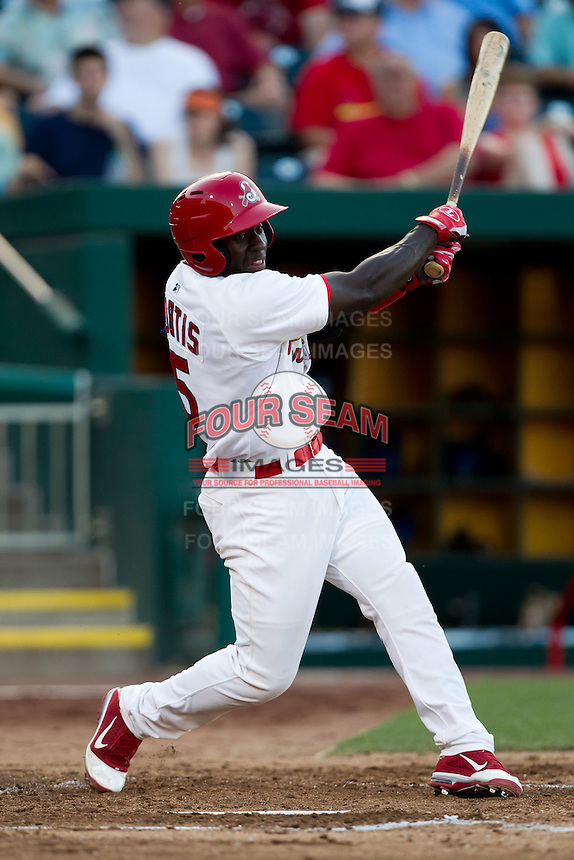 Jermaine Curtis (5) of the Springfield Cardinals follows through his swing during a game against the Tulsa Drillers at Hammons Field on July 19, 2011 in Springfield, Missouri. Tulsa defeated Springfield 17-11. (David Welker / Four Seam Images)