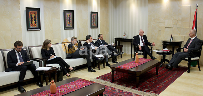A handout picture released by Prime Minister Office shows Palestinian Prime Minister Rami Hamdallah, meets with  Italian delegation, in the West Bank city of Ramallah on April 27, 2015. Photo by Prime Minister Office.