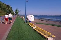 White Rock, BC, British Columbia, Canada - Seaside Promenade Walkway and Big Glacial Erratic Granite Rock painted White along Beach at Semiahmoo Bay