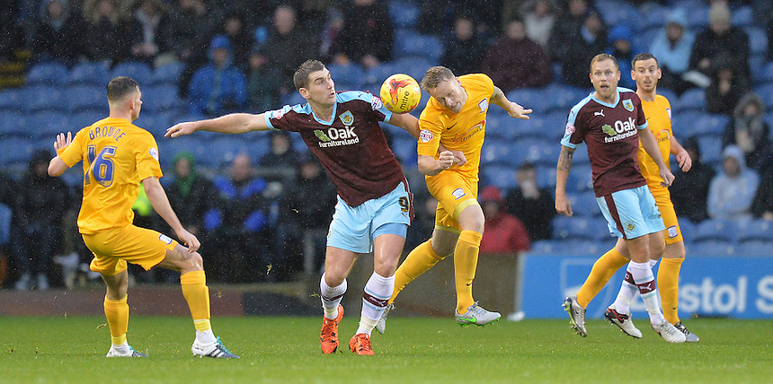 Burnley's Sam Vokes battles with Preston North End's Tom Clarke<br /> <br /> Photographer Dave Howarth/CameraSport<br /> <br /> Football - The Football League Sky Bet Championship - Burnley v Preston North End - Saturday 5th December 2015 - Turf Moor - Burnley<br /> <br /> &copy; CameraSport - 43 Linden Ave. Countesthorpe. Leicester. England. LE8 5PG - Tel: +44 (0) 116 277 4147 - admin@camerasport.com - www.camerasport.com