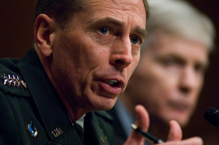 "WASHINGTON, DC - April 08: Gen. David H. Petraeus, the top U.S. commander in Iraq, and U.S. Ambassador to Iraq Ryan C. Crocker testify during the Senate Armed Services hearing on the situation in Iraq. Petraeus told Congress that he has recommended a halt to troop withdrawals for at least 45 days once the ""surge"" forces added last year depart this summer. If President Bush accepts the recommendation as expected, the number of U.S. troops in Iraq would level off at about 140,000 in July, down from about 156,000 now. After the pause, administration officials will decide if and when withdrawals might continue. (Photo by Scott J. Ferrell/Congressional Quarterly)"