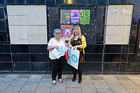 Pictured: Two party supporters with placards after the rally. Tuesday 30 April 2019<br /> Re: Nigel Farage and Anne Widdecombe at the Brexit Party rally at The Neon in Clarence Place in Newport, south Wales, UK.